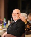 Senior man enjoying a party stock photography