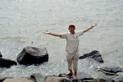 A senior man enjoying sea water. stock photos