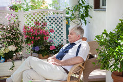 Senior man enjoying summer in garden Stock Image