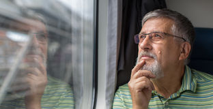 Senior man enjoying a train travel Stock Image