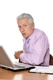 Senior man with euros and laptop Royalty Free Stock Photos