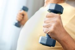 Senior man exercise at home health care with dumbbells body close-up Stock Photography