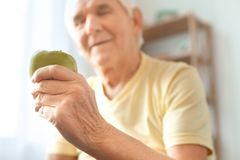 Senior man exercise at home health care healthy snack