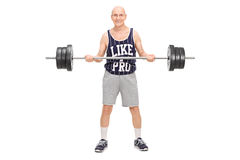 Senior man exercising with a barbell Stock Images
