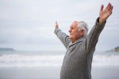 Senior man exercising on beach Royalty Free Stock Photography