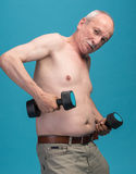 Senior man exercising with dumbbells Royalty Free Stock Photography