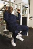 Senior Man Exercising In Gym Stock Photos