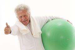 Senior man exercising at gym  with gym ball Royalty Free Stock Photos
