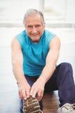 Senior man exercising at health club Royalty Free Stock Photography