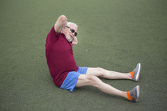 Senior man exercising in an open stadium Stock Photo