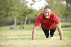Senior Man Exercising In Park Stock Image