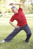 Senior Man Exercising In Park Royalty Free Stock Photography