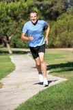 Senior Man Exercising In Park Royalty Free Stock Photos