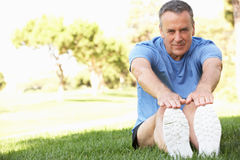 Senior Man Exercising In Park Royalty Free Stock Photo