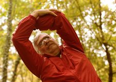 Senior man exercising in the park. royalty free stock image