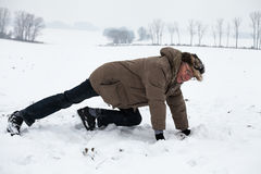 Senior man exercising on snow Royalty Free Stock Photography