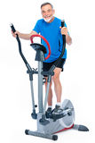 Senior man exercising on stepper Stock Photography