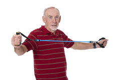 Senior man exercising with stretch band Stock Photo