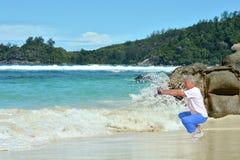 Senior man exercising in summer on  seashore Stock Photography