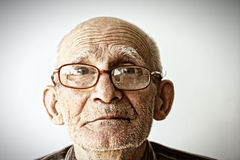 Senior man in eyeglasses. Closeup face portrait of senior man in eyeglasses Stock Images