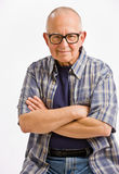 Senior man in eyeglasses with arms crossed Royalty Free Stock Photos