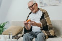 Senior man in eyeglasses and plaid looks stock photo