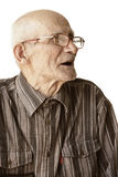 Senior man in eyeglasses sideview Stock Images