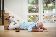 Senior man fallen down from stairs. At home Stock Photography