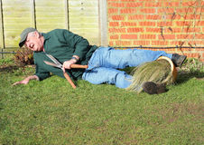 Senior man fallen over. Garden accident. Stock Image
