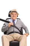 Senior man fastening his seatbelt Royalty Free Stock Photos