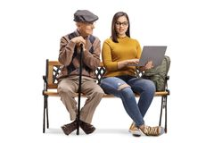 Senior man and female student with a laptop sitting on a bench. Senior men and female student with a laptop sitting on a bench isolated on white background royalty free stock photos