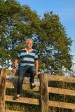 Senior man on fence Stock Photos