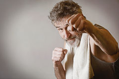 Senior man in fighting position Royalty Free Stock Images