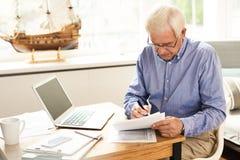 Senior Man Filing Tax Report stock image