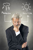 Senior man finding a solution Royalty Free Stock Photography
