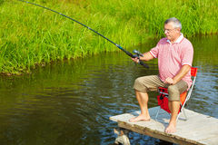 Senior man fishing Royalty Free Stock Photography