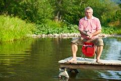 Senior man fishing. Photo of senior man fishing on weekend Royalty Free Stock Photos