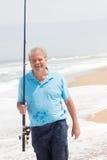 Senior man fishing Stock Photo