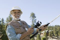 Senior Man Fishing. Portrait of happy Hispanic senior man enjoys a day of fishing Royalty Free Stock Photo
