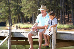 Senior man fishing with grandson Royalty Free Stock Images