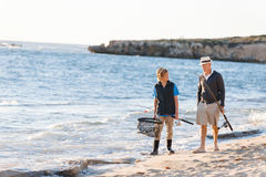Senior man fishing with his grandson Stock Images