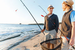 Senior man fishing with his grandson Royalty Free Stock Photography