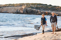 Senior man fishing with his grandson. Senior men fishing with his teenage grandson at seaside stock images