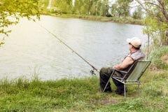 Senior man fishing. By the lake Stock Images
