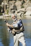 Senior Man Fishing On A Sunny Day Royalty Free Stock Photos