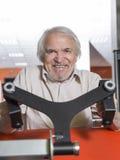 Senior man in fitness center Royalty Free Stock Image