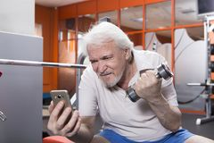 Senior man in fitness center Royalty Free Stock Photo
