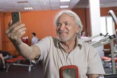 Senior man in fitness center Stock Photos