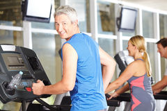 Senior man in fitness center on treadmill Royalty Free Stock Photography