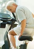 Senior man in a fitness club Stock Photography